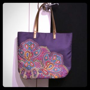 Purple tote bag with colorful paisley design